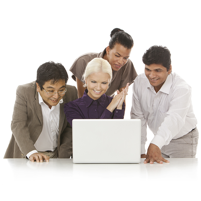 Multicultural group behind laptop